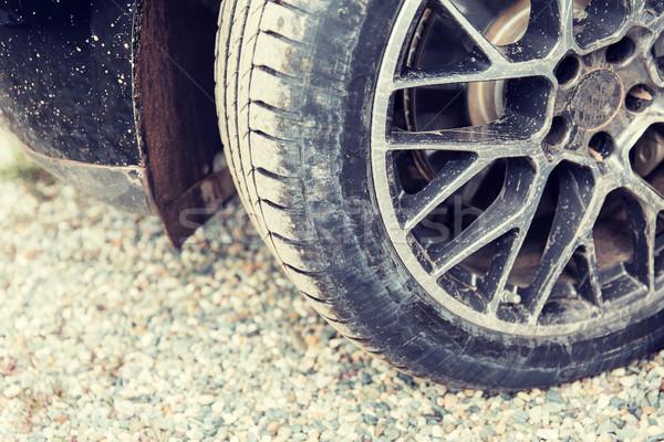 close up of dirty car wheel on ground Stock photo © dolgachov