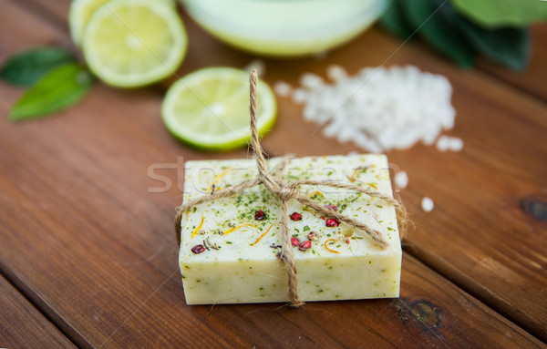 close up of handmade herbal soap bar on wood Stock photo © dolgachov