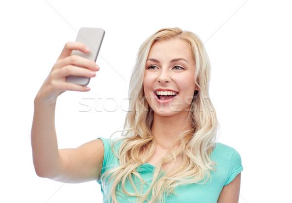 Stockfoto: Glimlachend · jonge · vrouw · smartphone · emoties · uitdrukkingen