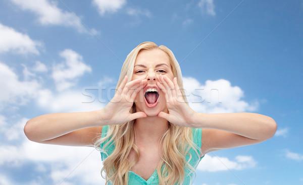 angry young woman or teenage girl shouting Stock photo © dolgachov