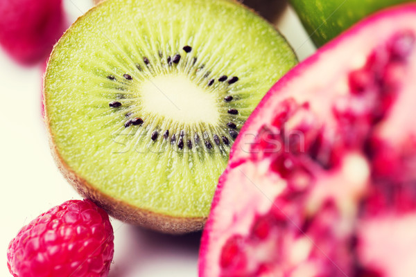 close up of ripe kiwi and other fruits Stock photo © dolgachov