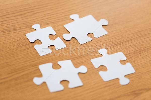close up of puzzle pieces on wooden surface Stock photo © dolgachov