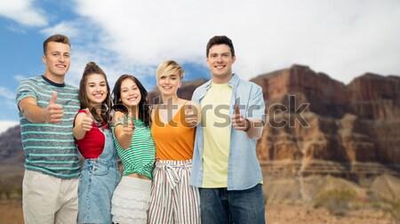 happy women pointing finger on you over coliseum Stock photo © dolgachov