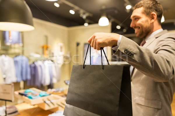 close up of man with shopping bags at store Stock photo © dolgachov