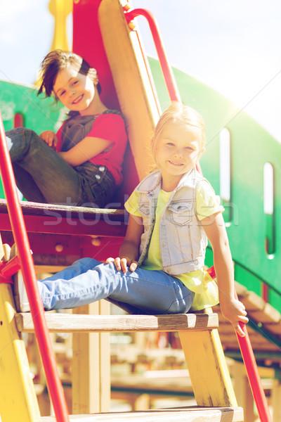 Felice ragazzi bambini parco giochi slide estate Foto d'archivio © dolgachov
