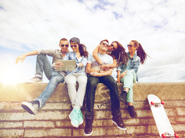 group of teenagers looking at tablet pc Stock photo © dolgachov