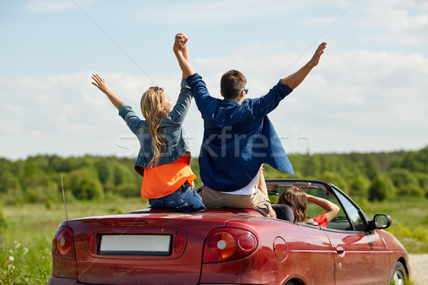 happy friends driving in cabriolet car at country Stock photo © dolgachov