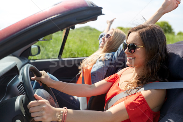 smiling young women driving in cabriolet car Stock photo © dolgachov