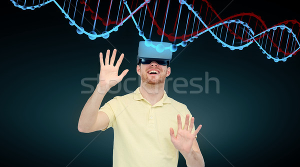 happy man in virtual reality headset or 3d glasses Stock photo © dolgachov