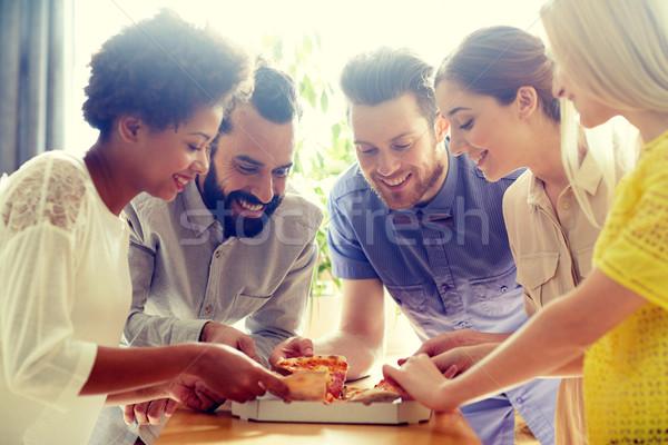 Zdjęcia stock: Szczęśliwy · zespół · firmy · jedzenie · pizza · biuro · działalności