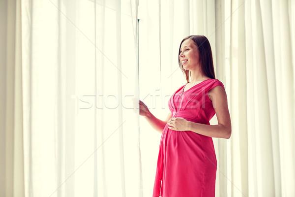 Boldog terhes nő nagy pocak otthon terhesség Stock fotó © dolgachov