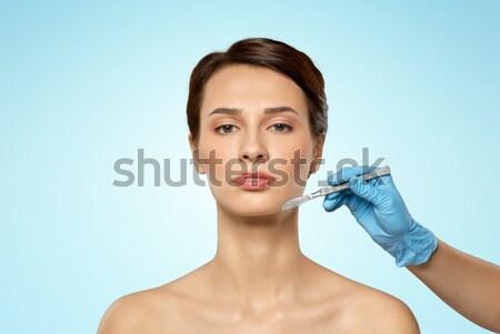 Cara da mulher mão seringa injeção pessoas Foto stock © dolgachov