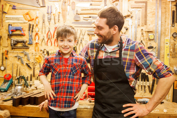 happy father and little son workshop Stock photo © dolgachov