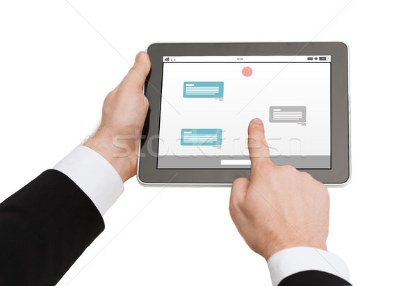 close up of hands holding tablet pc with messenger Stock photo © dolgachov