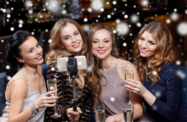 women with smartphone taking selfie at night club Stock photo © dolgachov