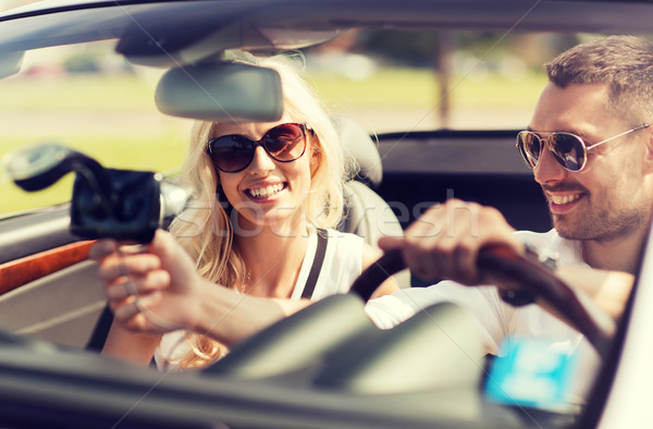 happy couple usin gps navigation system in car Stock photo © dolgachov