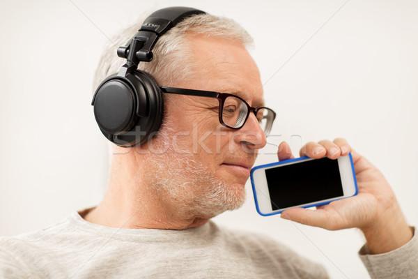 Feliz altos hombre auriculares tecnología Foto stock © dolgachov