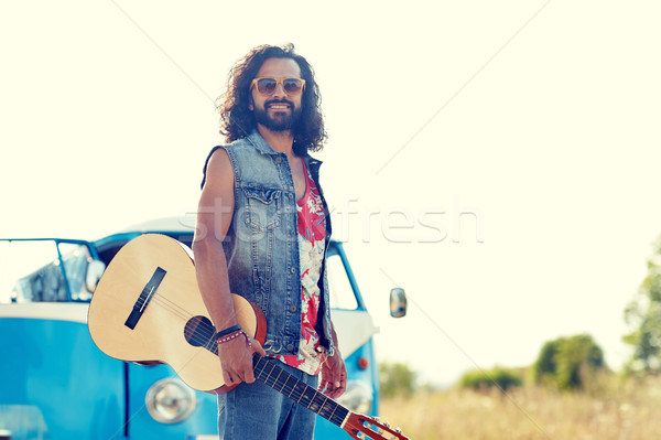 hippie man with guitar over minivan car outdoor Stock photo © dolgachov