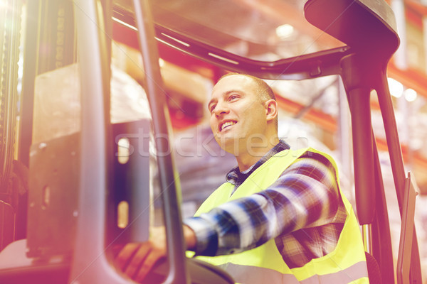 Stock photo: man operating forklift loader at warehouse