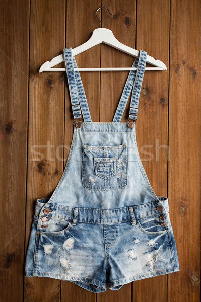 denim or jeans overalls with hanger on wood Stock photo © dolgachov