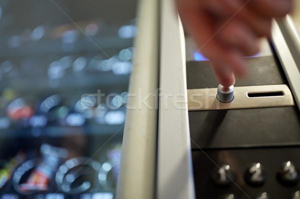 hand pushing button on vending machine Stock photo © dolgachov