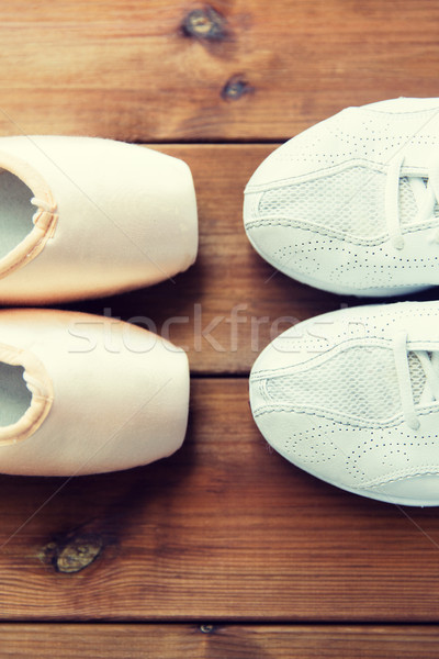 close up of sneakers and pointe shoes on wood Stock photo © dolgachov