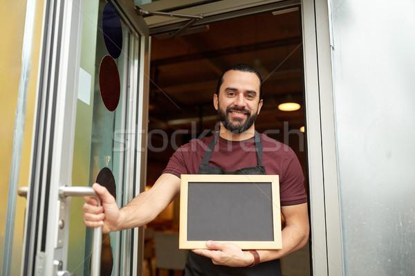 Adam garson tahta bar giriş kapı Stok fotoğraf © dolgachov