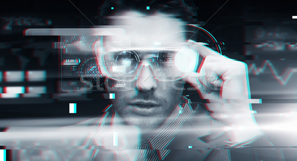 man in virtual reality or 3d glasses with glitch Stock photo © dolgachov