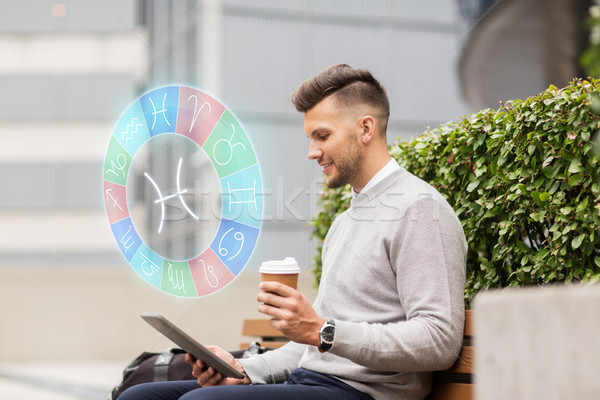 man with tablet pc and coffee in city Stock photo © dolgachov