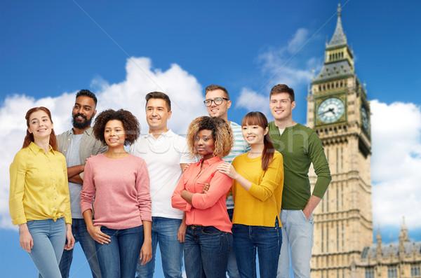 international group of happy people over big ben  Stock photo © dolgachov