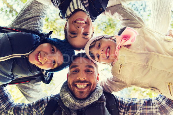 happy family faces outdoors at camp in woods Stock photo © dolgachov