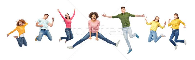 Gelukkige mensen vrienden springen lucht witte geluk Stockfoto © dolgachov