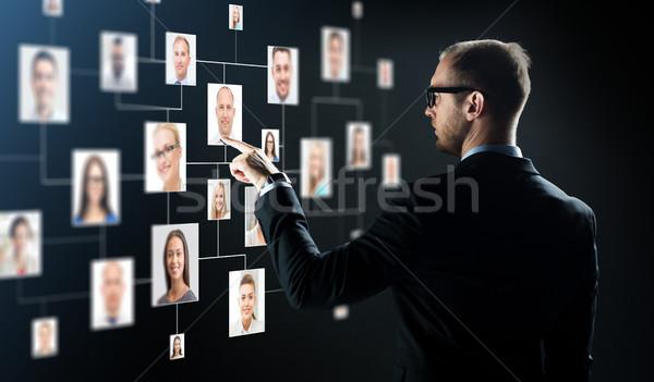businessman pointing finger to Stock photo © dolgachov