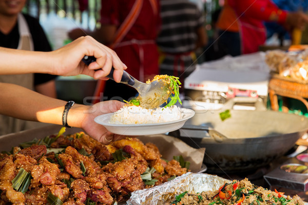 seller with rice and wok food at street market Stock photo © dolgachov