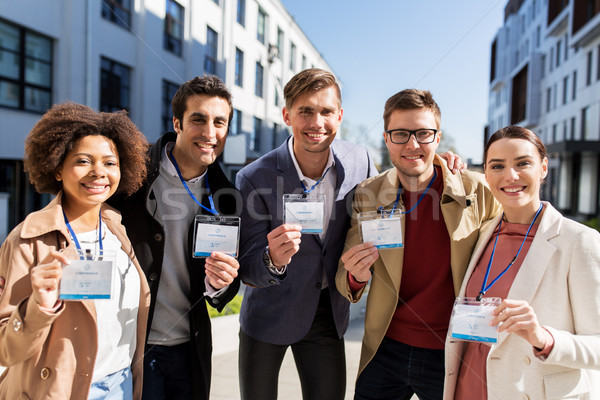 business team with conference badges in city Stock photo © dolgachov