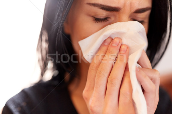 close up of woman with wipe crying at funeral Stock photo © dolgachov