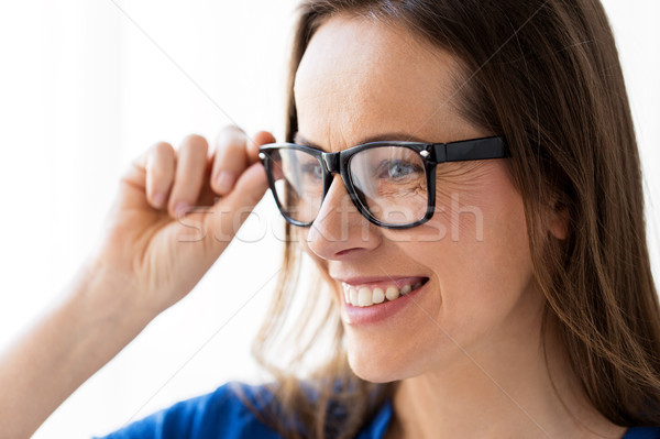Stock photo: close up of smiling middle aged woman in glasses