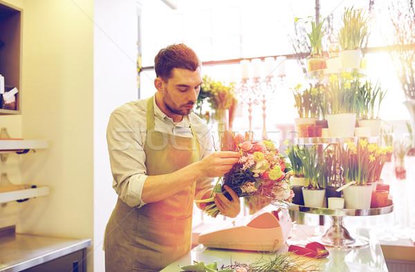 Florista homem monte pessoas Foto stock © dolgachov