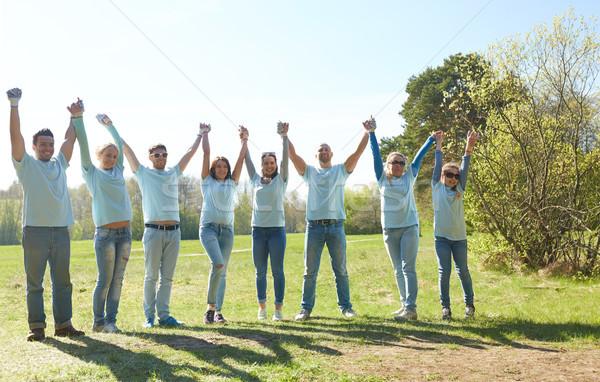 Csoport boldog önkéntesek kéz a kézben kint önkéntesség Stock fotó © dolgachov