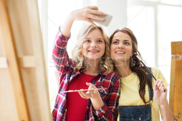 artist girls taking selfie at art studio or school Stock photo © dolgachov