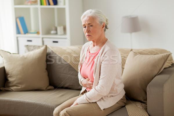 Senior mulher sofrimento dor de estômago casa Foto stock © dolgachov