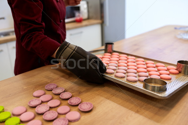 chef with macarons on oven tray at confectionery Stock photo © dolgachov