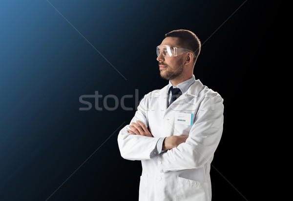 scientist in lab coat and safety glasses Stock photo © dolgachov