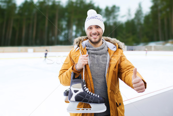 man showing thumbs up on outdoor skating rink Stock photo © dolgachov