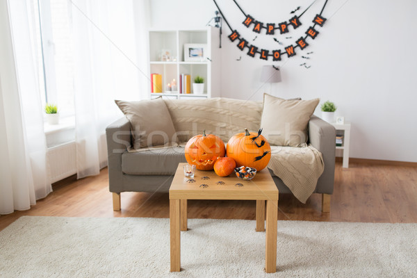 jack-o-lantern and halloween decorations at home Stock photo © dolgachov