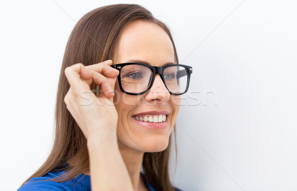 close up of smiling middle aged woman in glasses Stock photo © dolgachov