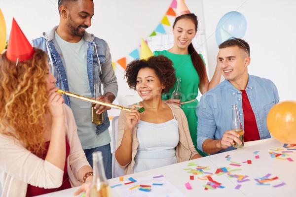 happy team having fun at office party Stock photo © dolgachov