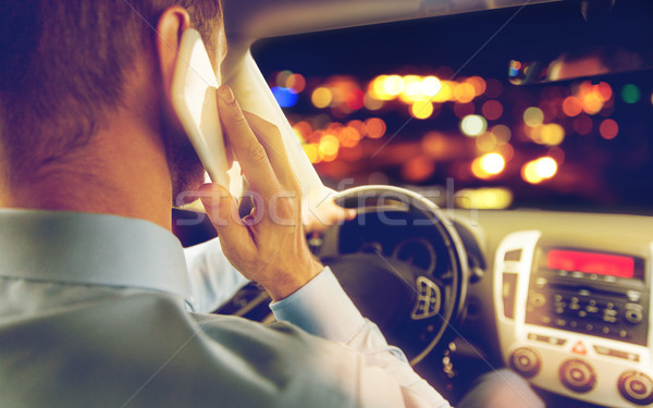 close up of man driving car calling on smartphone Stock photo © dolgachov