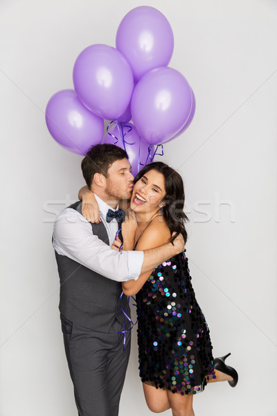 happy couple with violet balloons kissing at party Stock photo © dolgachov