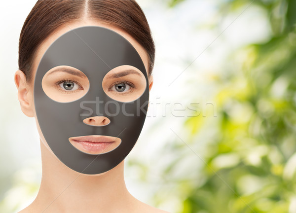 beautiful young woman with hydrogel mask on face Stock photo © dolgachov